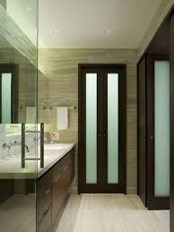 Inspiration for a mid-sized contemporary master beige tile bathroom remodel  in Chicago with an