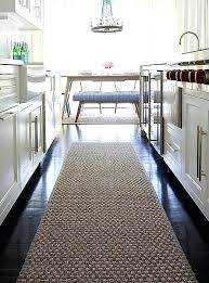 sisal runner a rug warms up the dark chocolate hardwood floors of this modern kitchen without