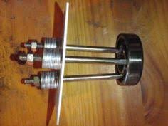 homemade blind hole bearing puller. homemade bearing puller constructed from aluminum plate, pvc, bolts, nuts, and washers. blind hole