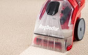 a mercial carpet cleaner steam cleans a carpet
