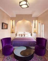 View in gallery Plush purple accents breathe life into the stylish Moroccan  bedroom