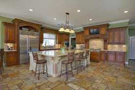 traditional kitchen with rustic cabinetry large island and travertine floor tiles