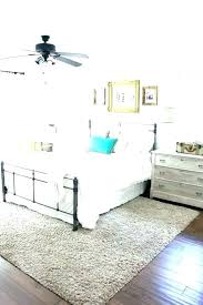 rug under queen size bed underneath area flawless master bedroom rugs lovely placement q