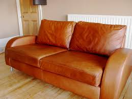 leather sofa damaged by sunlight treated and colour red after