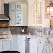 blue kitchen cabinets with fantasy brown granite countertops