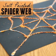 Today we are excited to share how we painted salt to create a beautiful spider  web and enjoy a cool salt reaction!