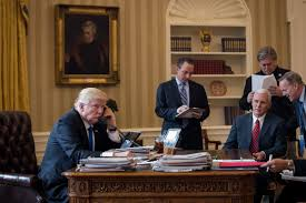 president in oval office. President Donald Trump Speaks On The Phone With Russian Vladimir Putin In Oval Office Of White House, January 28, 2017, Washington, DC. R