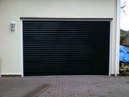 black garage doorBlack Insulated Roller Garage Door  Abbey Garage Doors