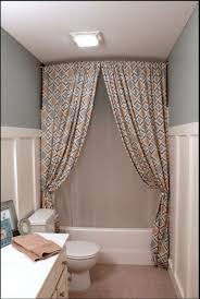hang a shower curtain all the way up to ceiling make