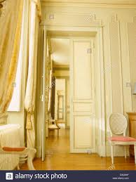 open double door drawing. Silk Drapes On Tall Windows In Opulent French Chateau Dining Room With Double Doors Open To Drawing Door L