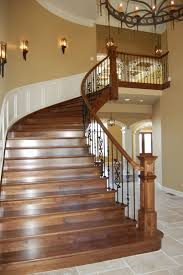 Custom Walnut Stair w/ wrought iron rails RL Builders Custom Luxury Homes