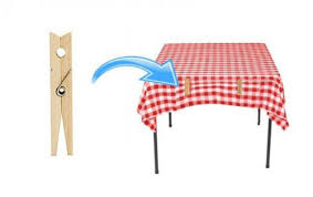 hold down your tablecloth using clothes pegs