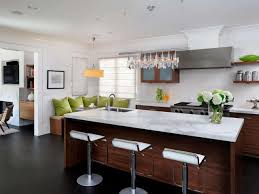 Modern Kitchen With Marble Countertops And Multiple Pendants