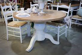 image of distressed round dining table and chairs