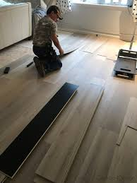 picking the right planks out of stack of vinyl wood plank flooring