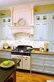 blue painted cabinets. Fine Painted Pale Blue Cabinets Paired With Sparkly Subway Backsplash And A Hint Of Pink  Fireplace And Painted E