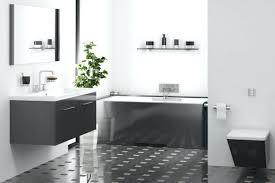 a simple overhauled bathroom in grey painted walls shimmering dark vanities and elegant green wall tiles color scheme ideas