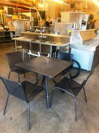 black mesh outdoor table and chair