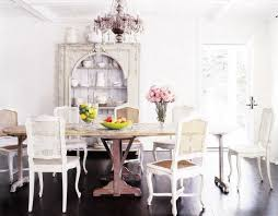 antique white wash dining set. french dining room design with espresso stained wood floors, antique table, cane back chairs, white washed wash set e