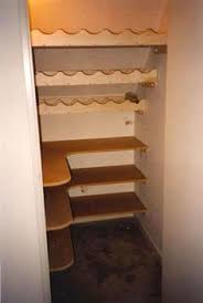 Maybe the real solution is to just rip out the big shelf across the middle  and put in something like this under stairs