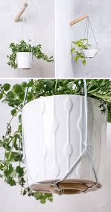 these wall planters allow you have hanging plants wherever you want them simply by attaching them to a wood pole mounted to the wall