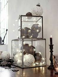 modern christmas decor: ornaments in clear boxes + star stringlights |  #holidays black /