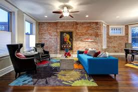 living room accent wall stump side table design odern white sofa red area rug blue teal
