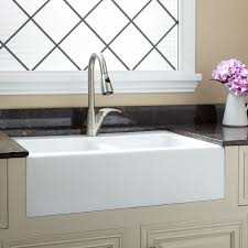 this double bowl sink has two deep wells for accommodating large cookware and a durable cast iron surface that resists chipping and heat 926370