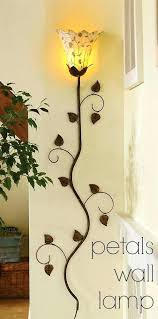 metal wall sconces for flowers petals wall lamp doubles as a unique piece of wall art
