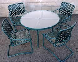 tropitone marakesh vinyl lace chairs