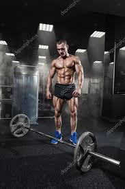 muscular man workout with barbell at gym deadlift barbells work stock photo