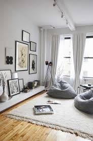 No furniture living room Room Ideas Love The Boho Look To This Living Room No Couches Or Chairs Pinterest This Couples Insanely Chic Apartment Is Also Their Storefront