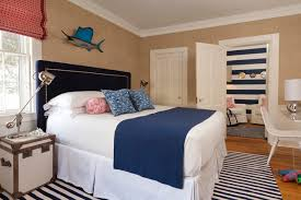 bedroom beach style light wood floor bedroom idea in boston with beige walls