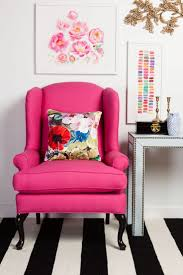 black and white rug with bold pink wingback chair