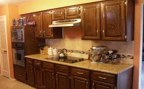 recessed lighting for kitchen decoration with oak wood lowes kraftmaid cabinet and granite kitchen countertop plus wood flooring design