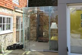 church house sus bespoke structural glass linkway frameless glass doors