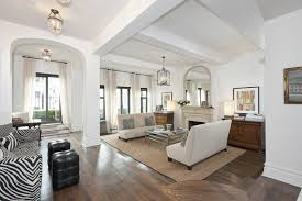 180 east 79th street listed at 2 2 million feels extra airy squint and it could be a lounge in a caribbean resort thanks to large sunken living room