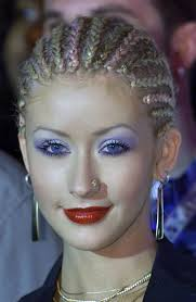 here christina aguilera teams the tight braids with bright blue shadow a double whammy for the 90s trends we