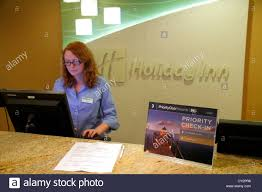massachusetts cape cod hyannis holiday inn motel hotel lobby front desk clerk check in computer woman job service