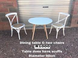 small round table and two chairs for