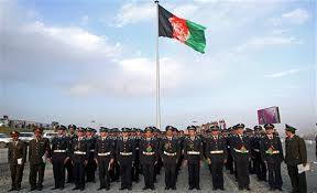 afghanistan s military academy students stand guard in front of the largest ever afghan flag to fly