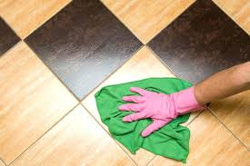 how to clean a ceramic floor a person wiping down a tiled floor clean ceramic floor