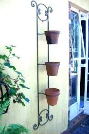 free standing wrought iron plant hangers rers forged iron plant hanger wrought hangers outdoor architecture synonyms