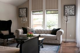 beige reclining sofa living room transitional with square clock blue and white rug beige walls