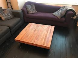 solid wood coffee table industrial style with metal wheels
