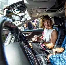 theresa l egan missioner of the nys dmv left speaks with an audi