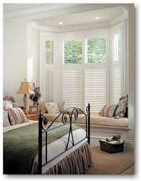 Master Bedroom Window Treatments: White Composite Shutters Bay Window  Coverings - traditional - window blinds - st louis - by Two Blind Guys.
