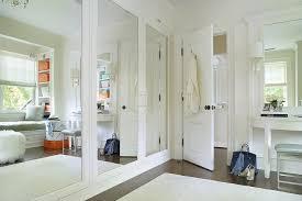 walk in closet with mirrored closet doors