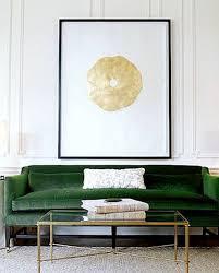 green sofa with art emerald decor