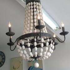 wooden bead chandelier seaside bungalow wood bali